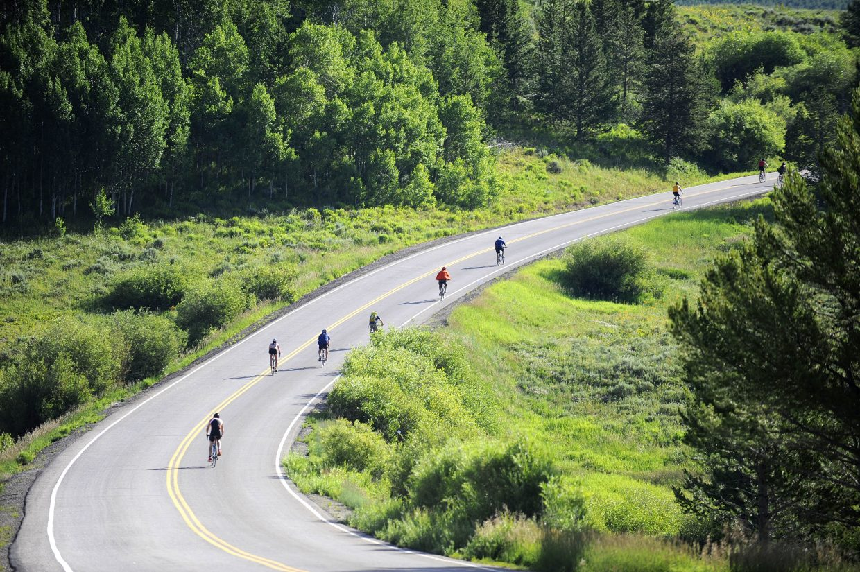 Cyclists climb the big hill during Sunday's Steamboat Lake Triathlon.