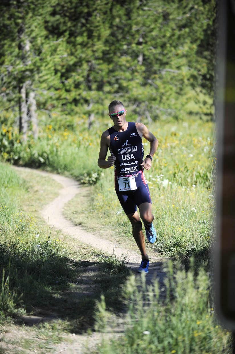 Mens winner William Jurkowski approaches the finish line during Sunday's Steamboat Lake Triathlon.