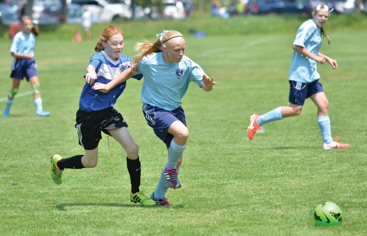 Steamboat Springs' Alexa Paoli battles for the ball during a 2-1 win against the Select O2G team during a game on the first day in the Steamboat Mountain Soccer Tournament. The teams were playing in the U12 Bronze girls division. Steamboat has several teams in the annual tournament, which draws teams from across the state and nation.