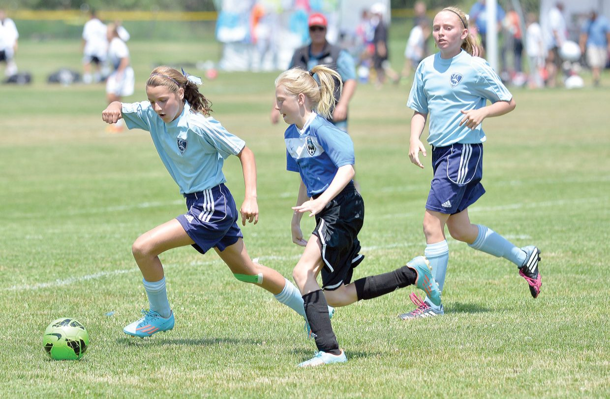 Riley Hodges, of the Steamboat Springs U12 Navy team, controls the ball in a game Friday afternoon against O2G on the first day of the Steamboat Mountain Soccer Tournament. The Steamboat girls, just one of many teams playing in this weekend's tournament, scored two first half goals and then held on down the stretch for a 2-1 victory.