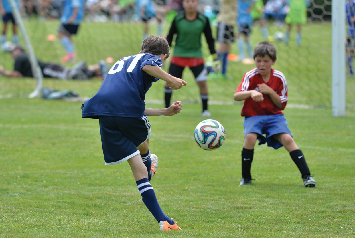 Joshua Hamilton, of the Steamboat Springs U11 Navy team, fires a shot on goal in a game Friday afternoon against the Indos on the first day of the Steamboat Mountain Soccer Tournament. The Steamboat boys, just one of many teams playing in this weekend's tournament, topped the Indos by a final score of 9-6.