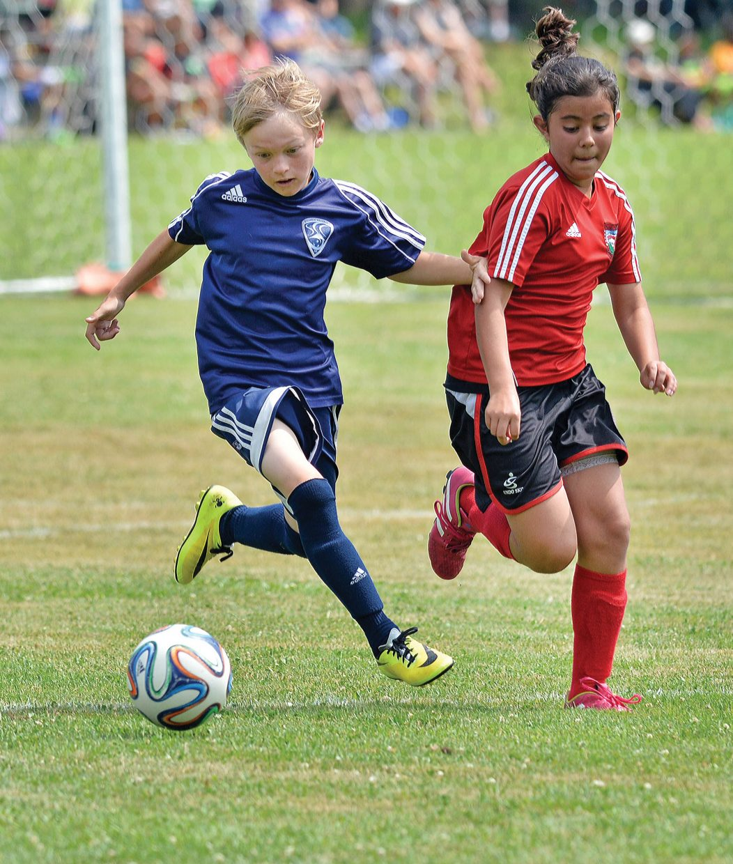 Ethan Spence, of the Steamboat Springs U12 Navy team, controls the ball Friday afternoon in a game against the Indos on the first day of the Steamboat Mountain Soccer Tournament. The Steamboat boys, just one of many teams playing in this weekend's tournament, topped the Indos by a final score of 9-6.