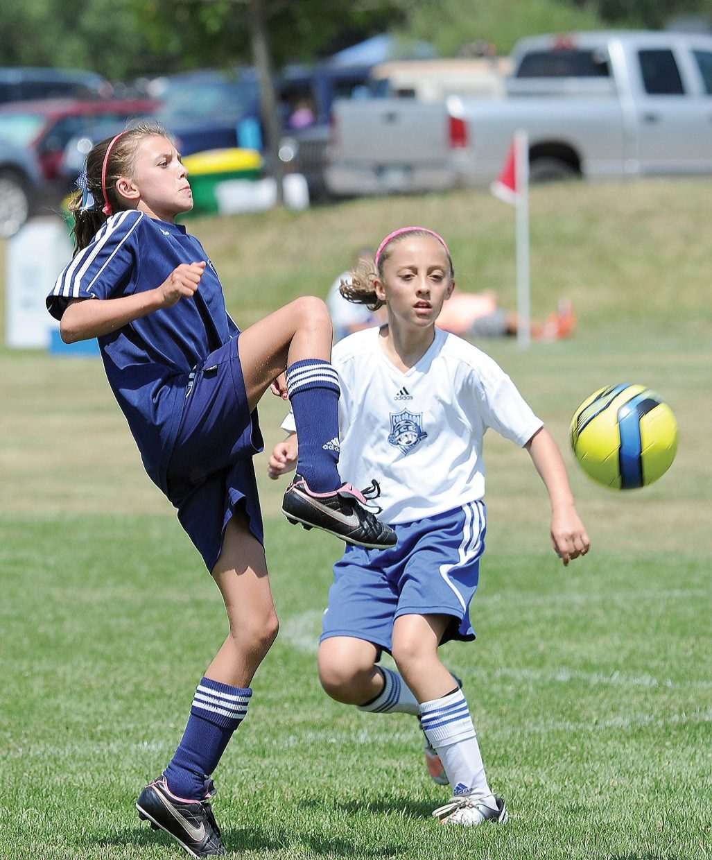 Steamboat Springs soccer player Maggie Congdon hits the ball out of the air during a 3-0 win against the Black Ice in Saturday's action. The U12 Steamboat Navy girls team won all three pool play games and will face the NTX Reign from Utah at noon today in the bronze division championship at Heritage Park. The boys U12 team will also play for the championship against Forza FC in the silver division. That game begins at 10 a.m. and also is at Heritage Park
