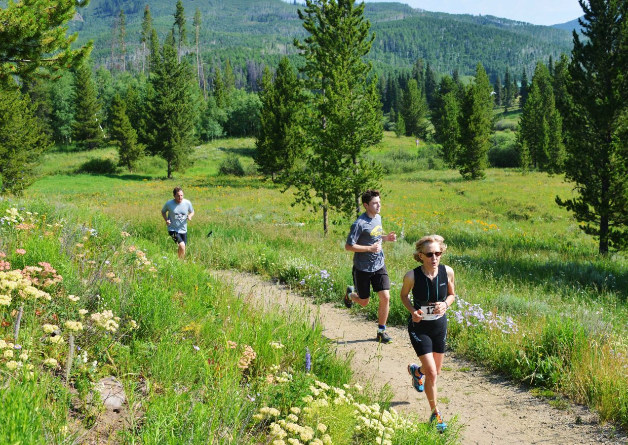 Karen Olson, from South Dakota, leads a group of runners Sunday on the trail during the Steamboat Lake Sprint Triathlon in North Routt County. The event produced about 230 finishers, some from Routt County, some from Colorado and some more from all corners of the United States.