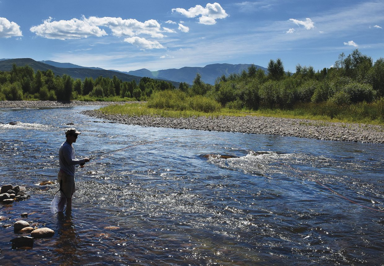 Matt Walker tries his luck Monday morning in the Yampa River west of Steamboat Springs. Walker was visiting with his family from Toronto and just learned to fly fish a few days ago.