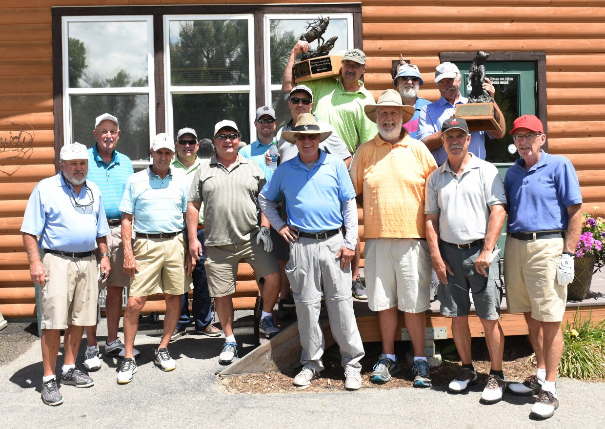 The Steamboat Golf Club men's league poses with its two traveling trophies. It just won the elk trophy by defeating Grand Lake in a series of matches. It will next try to defend the bear statue against Craig later this summer.
