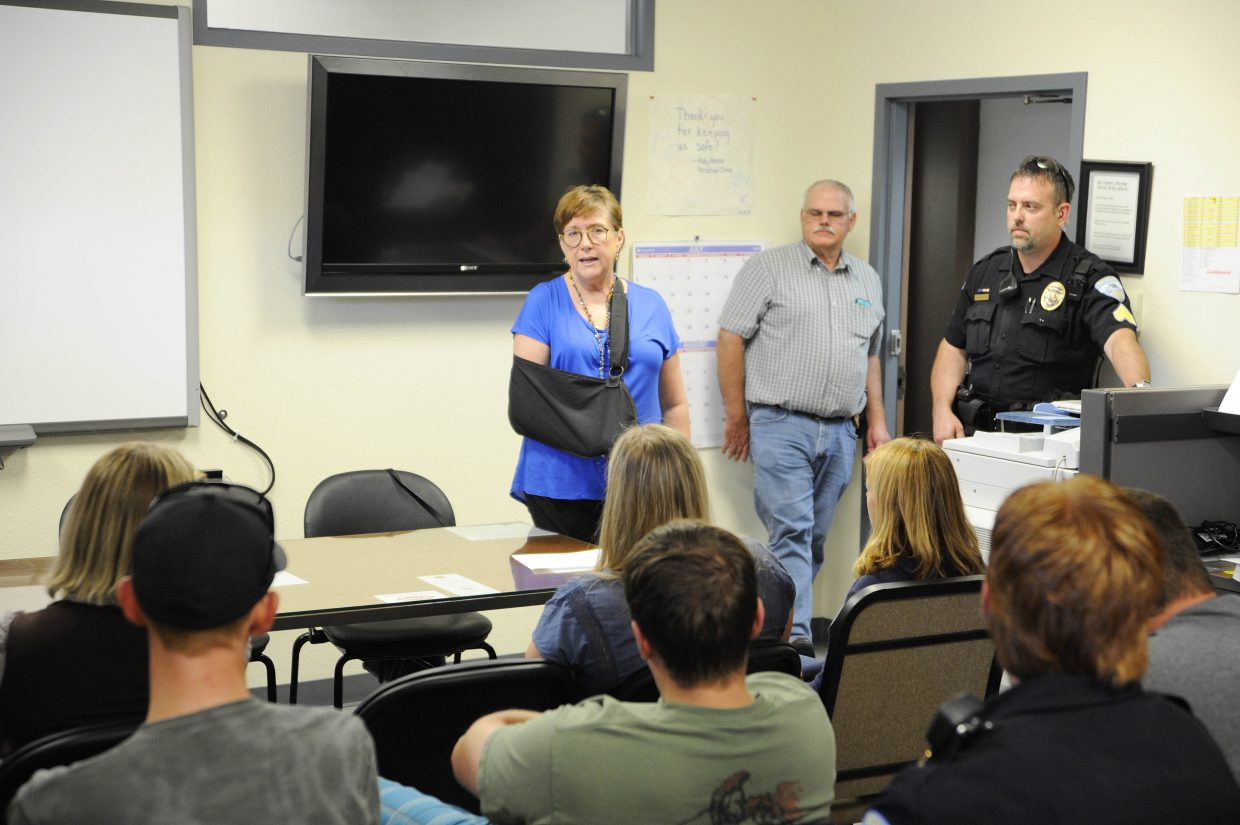 Steamboat Springs City Manager Deb Hinsvark speaks to police department employees before a city council meeting.