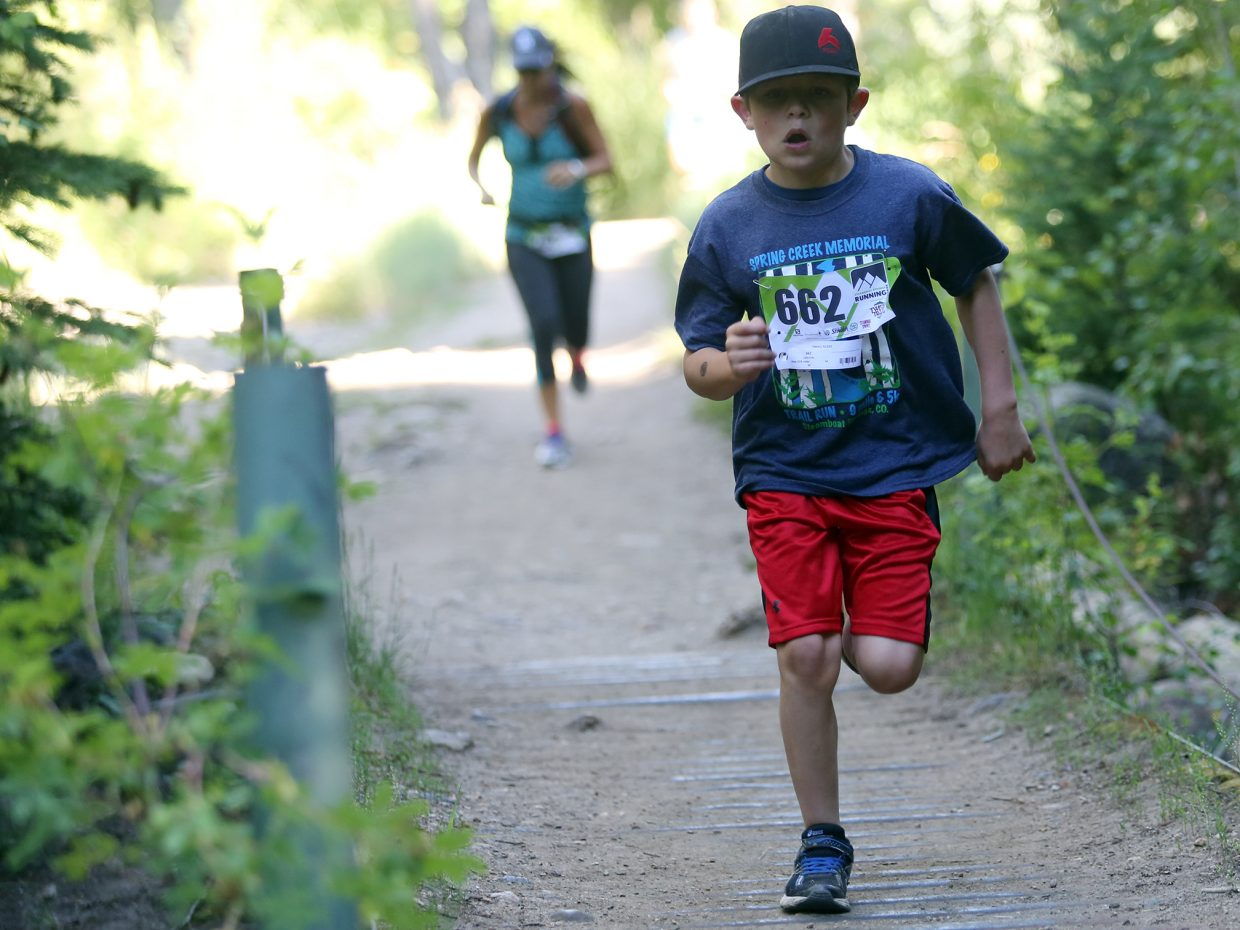 Colin Fritz crosses a bridge along Spring Creek during last year's Spring Creek Memorial 5K trail run. The race returns for 2016 on Saturday.