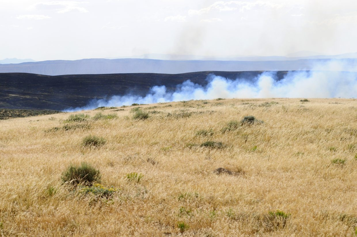 The southern edge of the Alkali fire burns Moffat County land.