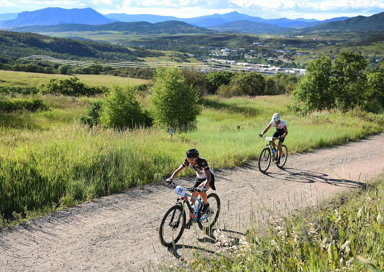 Mindy Mulliken leads a pack of riders uphill Wednesday during a Town Challenge mountain bike race on Emerald Mountain.