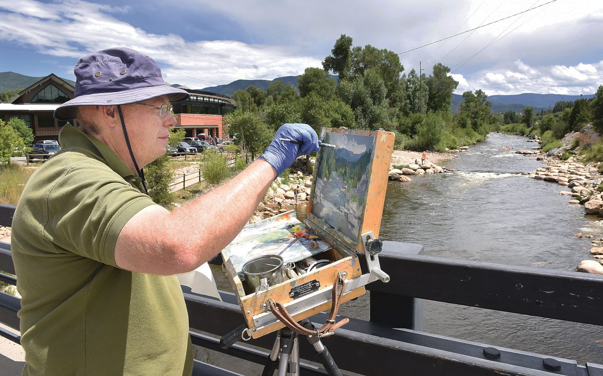 Plein air painter Tim Deibler, who lives in Walsenburg, but shows his work in Steamboat Springs at the Wildhorse Gallery, paints the scene of the river from the 13th street bridge.