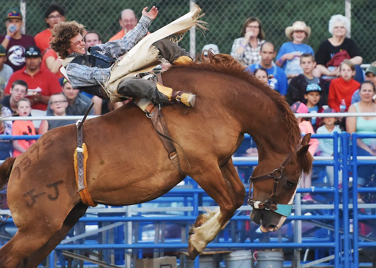 Levi Nicholson, from Severance, couldn't hang on to his hat but could hang on to First Catch, the horse he drew in Friday's bareback riding competition at the Steamboat Springs Pro Rodeo Series. The series returns at 7:30 p.m. today, then every Friday and Saturday into August.