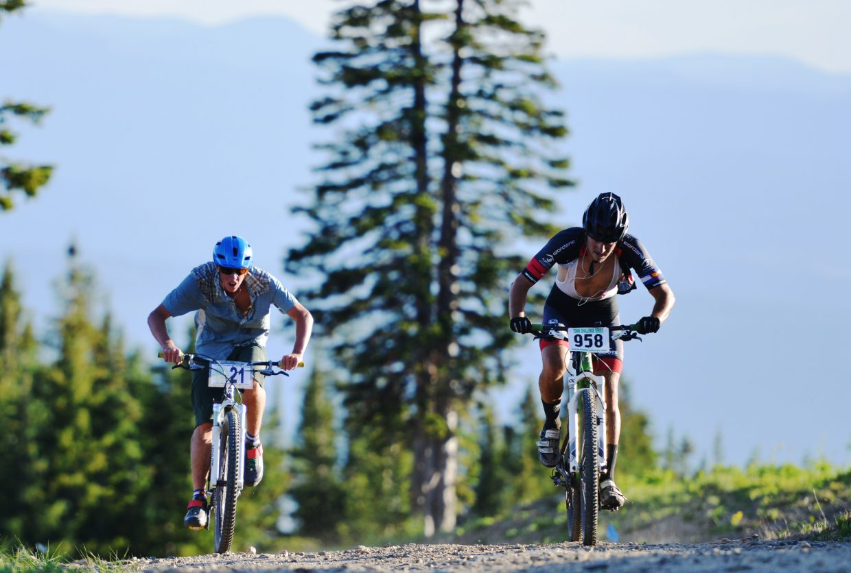 Tyler Gilman, left, and Jackson Morgan charge toward the finish line of Wednesday's Town Challenge mountain bike race.