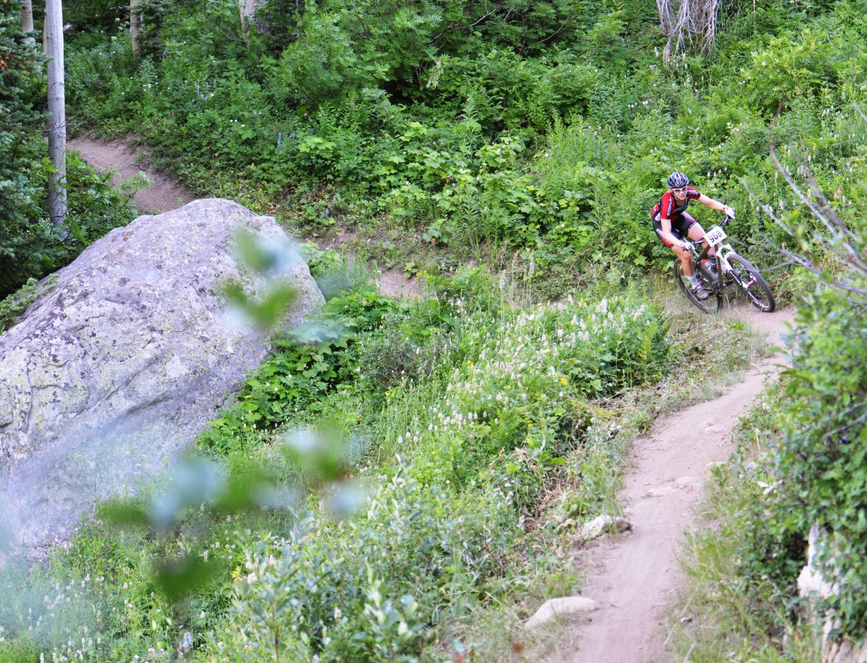 Linnea Dixson cuts down the trail during Wednesday's Town Challenge mountain bike race at Steamboat Ski Area.