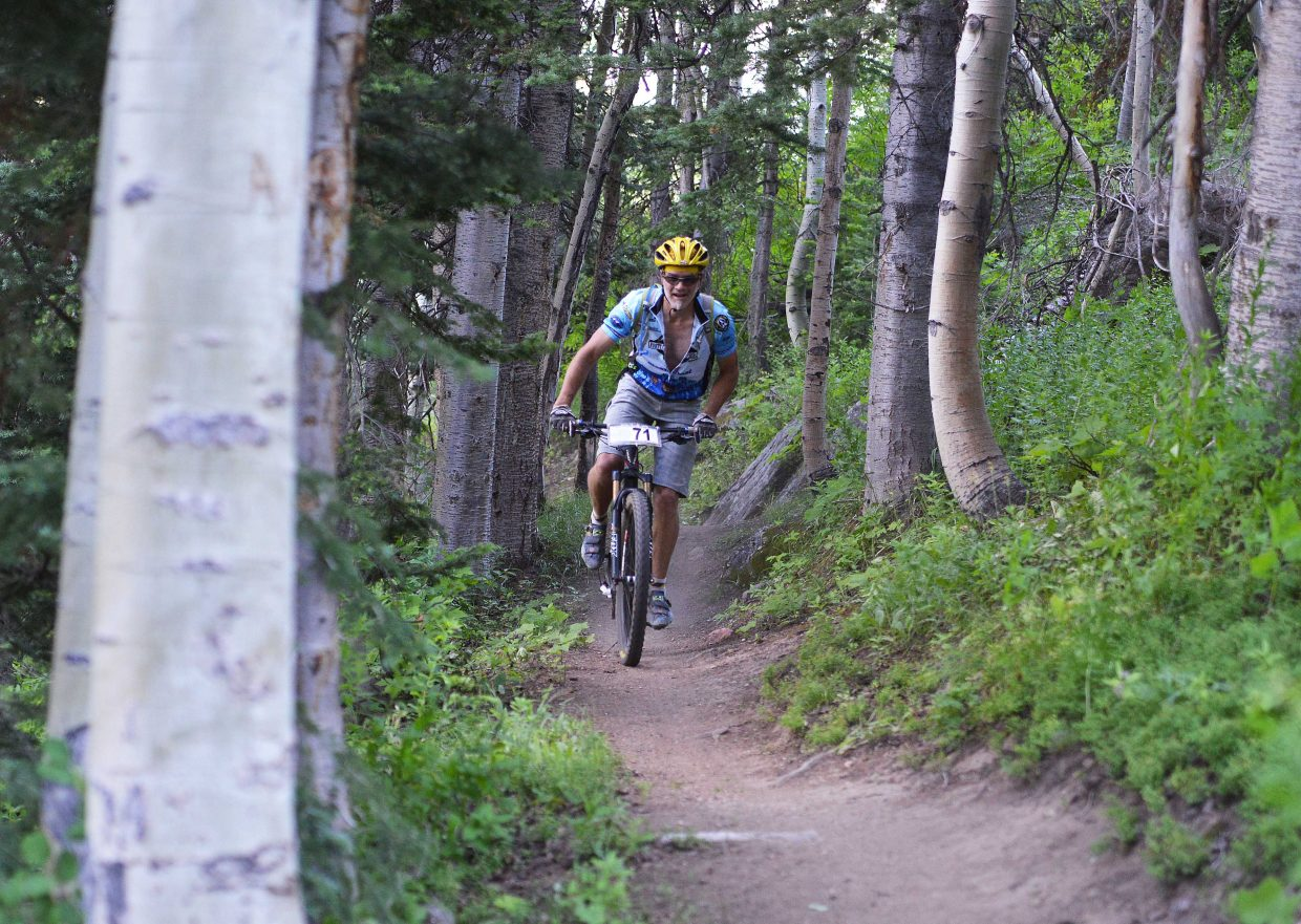 Chris Speer rides on Mount Werner at Steamboat Ski Area in Wednesday's Town Challenge mountain bike race.