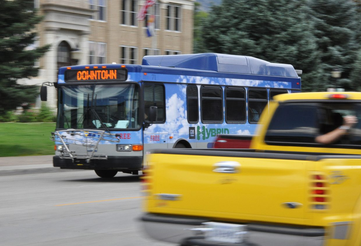 A Steamboat Springs Transit bus cruises through downtown Steamboat.