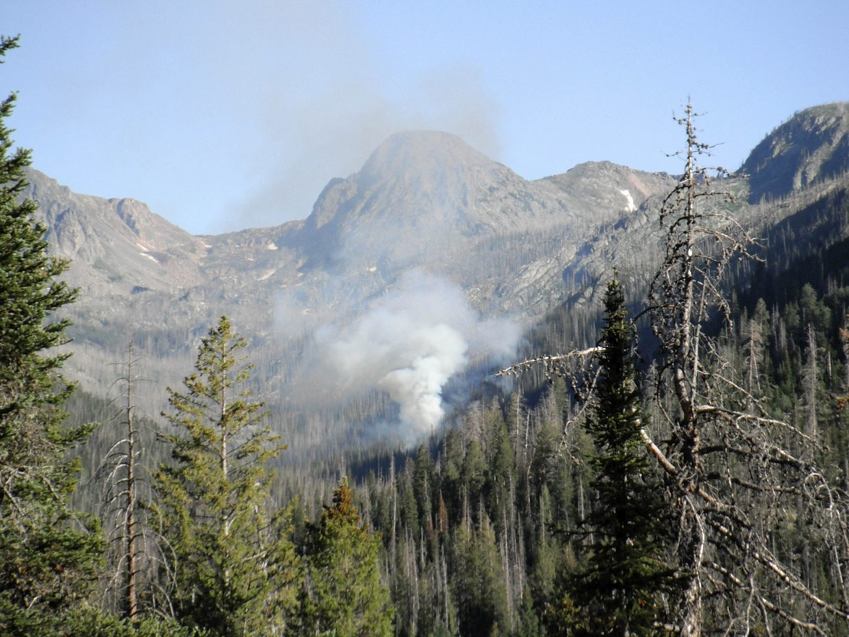 A wildfire burns Tuesday in the Mount Zirkel Wilderness Area. It's approximate size was 6 acres.