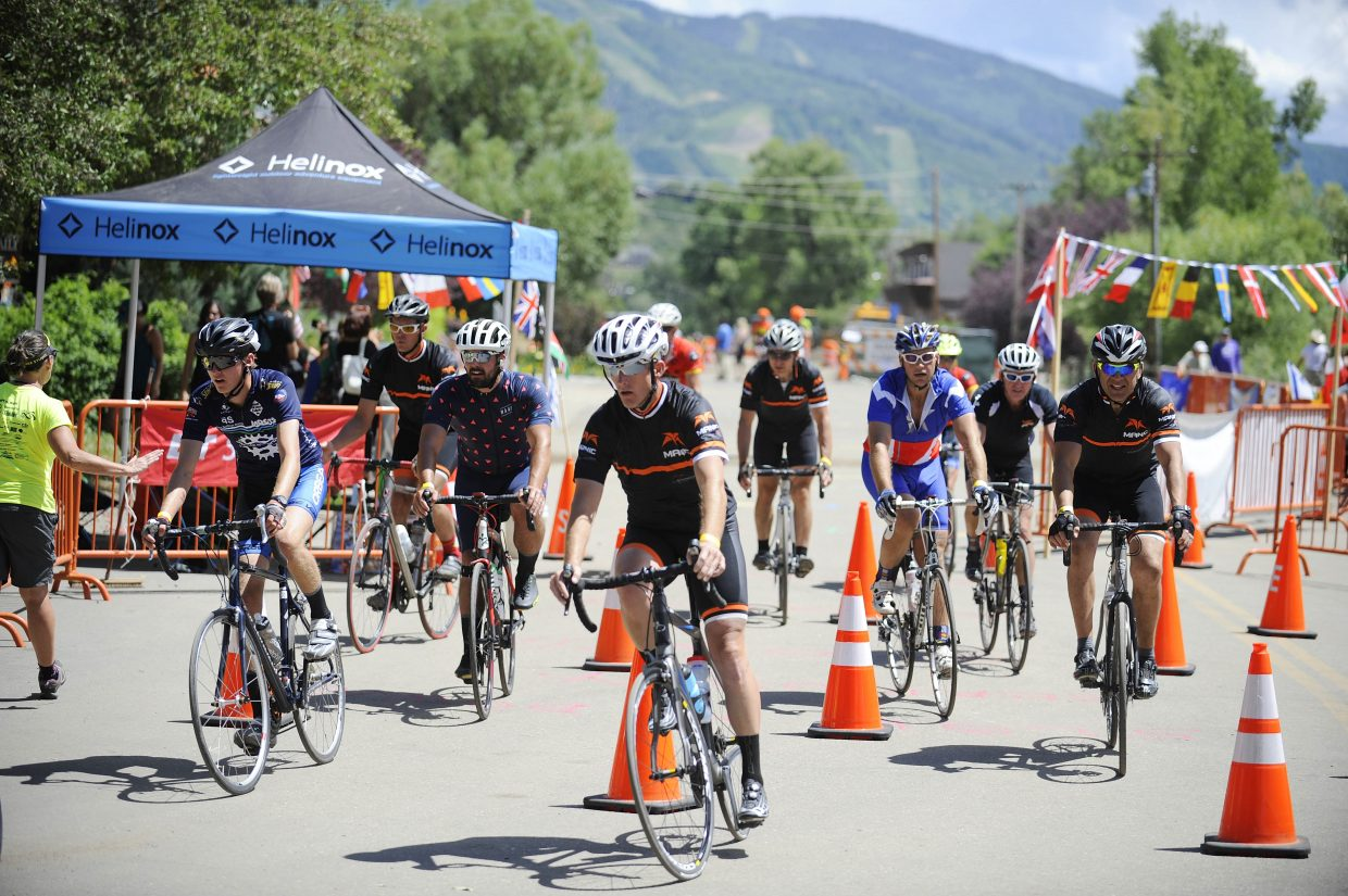 A crew of cyclists with the Manic Training gym crosses the finish line Saturday after completing the 116-mile Tour de Steamboat course.