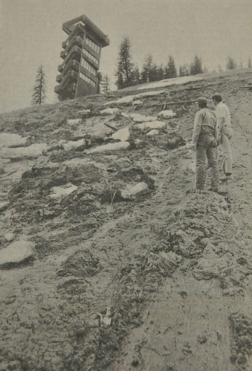 Steamboat Parks and Recreation Director John Thrasher and Howelsen Hill lift operator Pat Nadon survey damage create by mud slides at Howelsen Hill in May 1982.