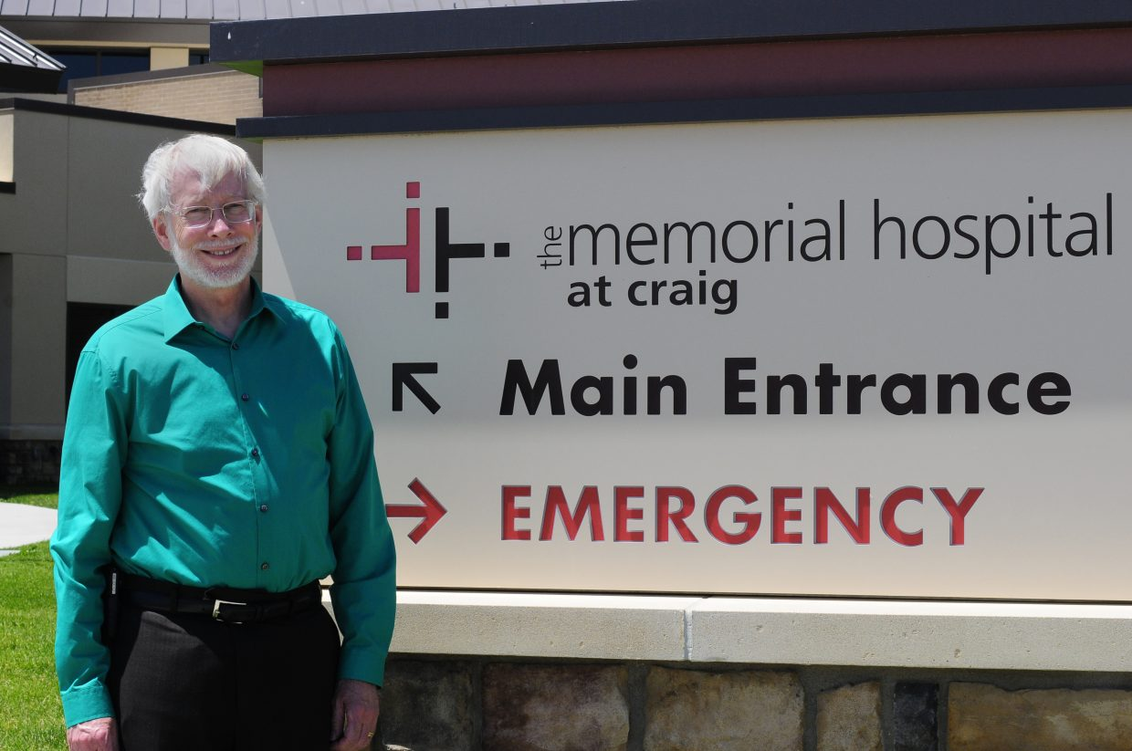 John Rossfeld smiles near the main entrance of The Memorial Hospital. Rossfeld was named permanent CEO of TMH after serving as interim CEO for six months.