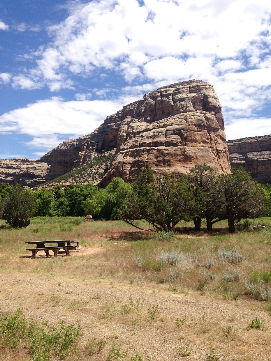 Steamboat Rock protrudes into the sky at Echo Park camping area in Dinosaur National Monument in Moffat County.