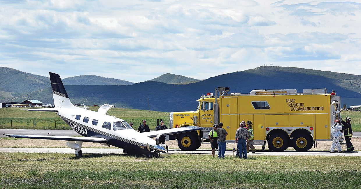 Investigators and emergency responders surround a single engine airplane that ran off a taxiway at the Yampa Valley Regional Airport Friday afternoon.