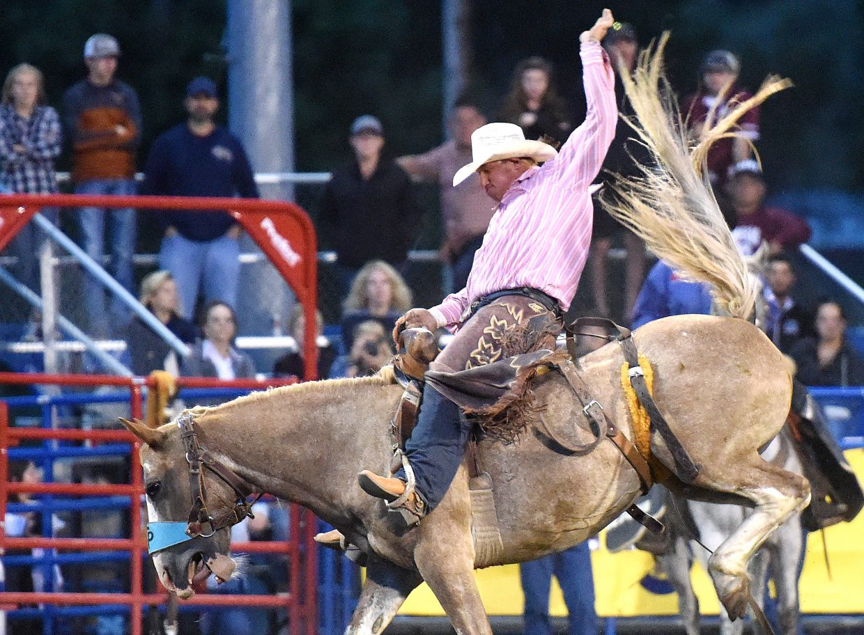 Wyatt Uptain tries to hang on to his bronc Friday at the Steamboat Springs Pro Rodeo. Uptain and his brother, both Moffat County High School graduates living in Hayden, have big dreams in the rodeo world and are regulars at the weekly Steamboat series.