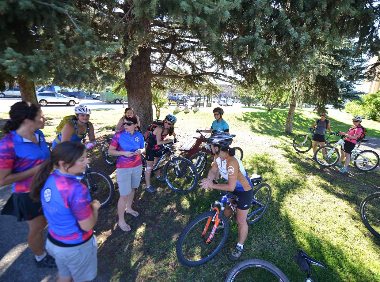 Abi Slingsby talks to the women's mountain bike clinic riders Tuesday evening in Steamboat Springs. She's one of the leaders of the weekly class that draws dozens of athletes.