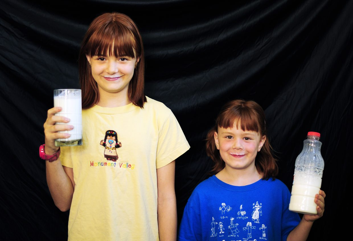 Sisters Brieann Robertson, 10, and Cassandra Robertson, 6, of Craig, enjoy drinking whole milk.