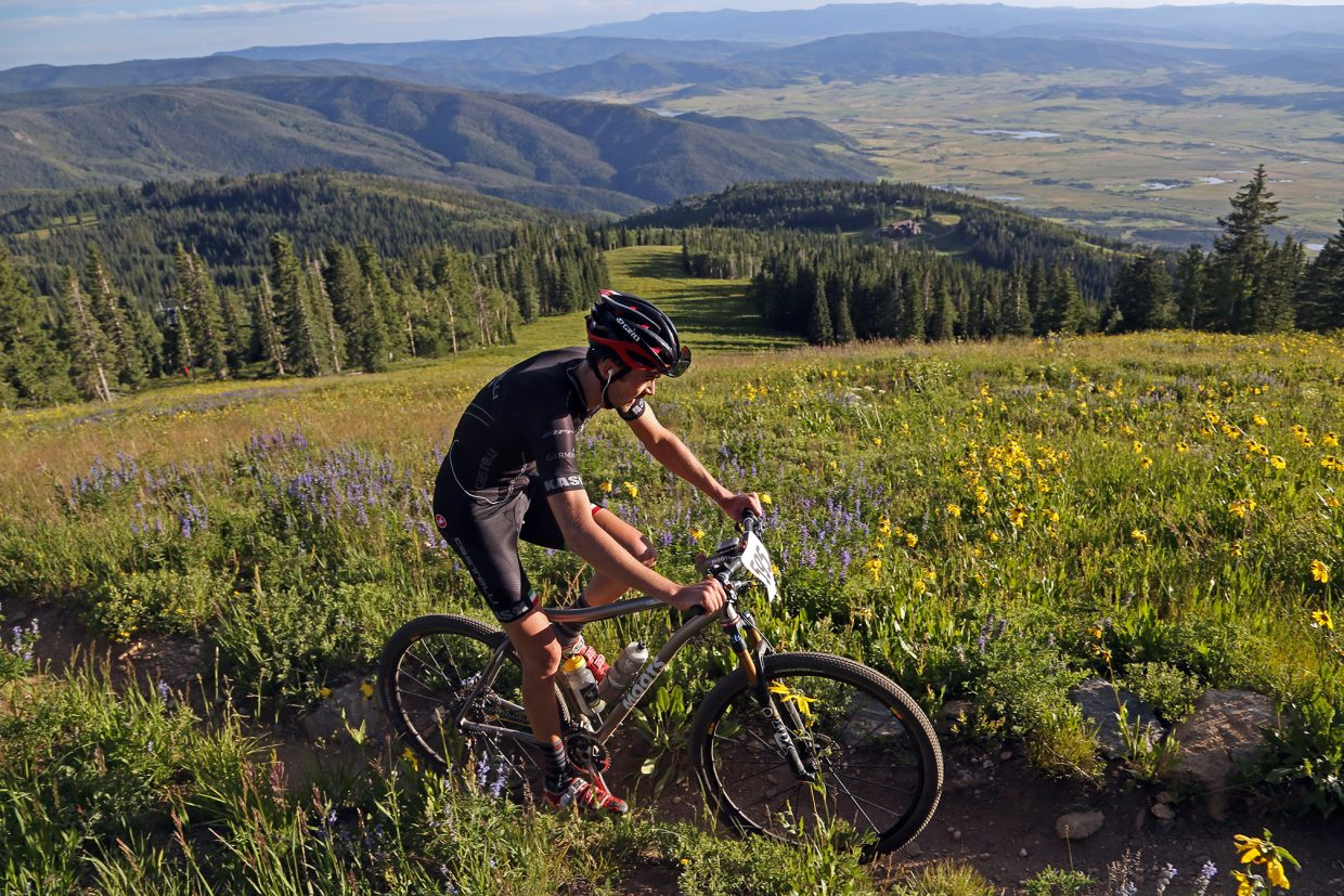 Butch Boucher competes in the Storm Peak Hill Climb on Mount Werner last year. The gritty Town Challenge Mountain Bike Race Series returns Wednesday.
