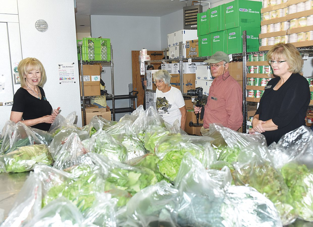 Lynn Nyen, emergency assistance and food bank manager, speaks to a group that toured the new LiftUp of Routt County Food Bank Tuesday morning. The expanded food bank, which opened last month, is expected to provide better services to clients in the area as well as more fresh produce and proteins.