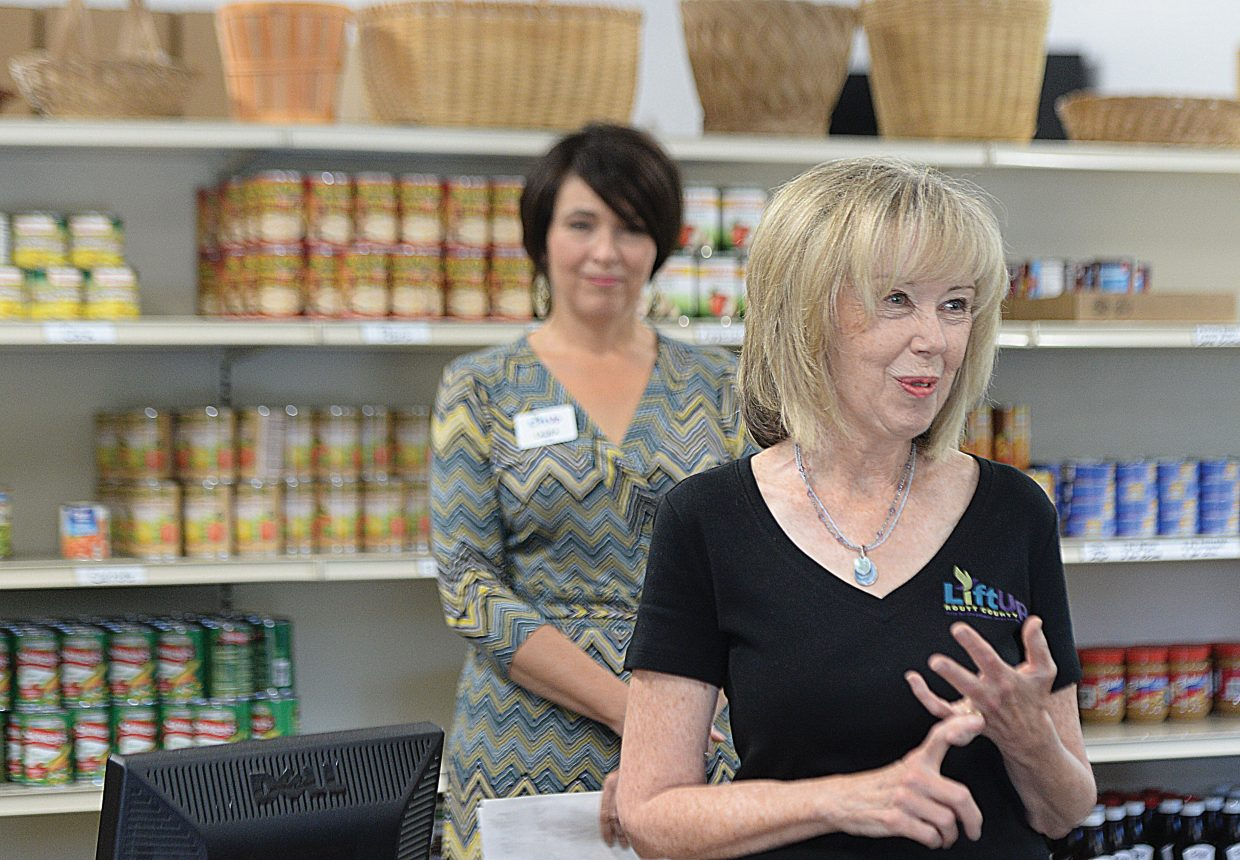 Lynn Nyen, emergency assistance and food bank manager, speaks to a group that toured the new LiftUp of Routt County Food Bank Tuesday morning.