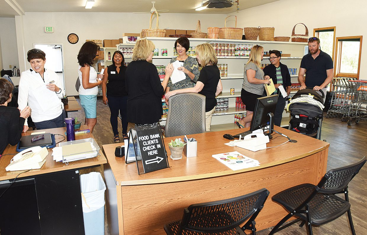 Visitors take a tour of the new LiftUp of Routt County Food Bank Tuesday morning. The expanded food bank opened last month and is part of a project that also included expanding the thrift store next door.