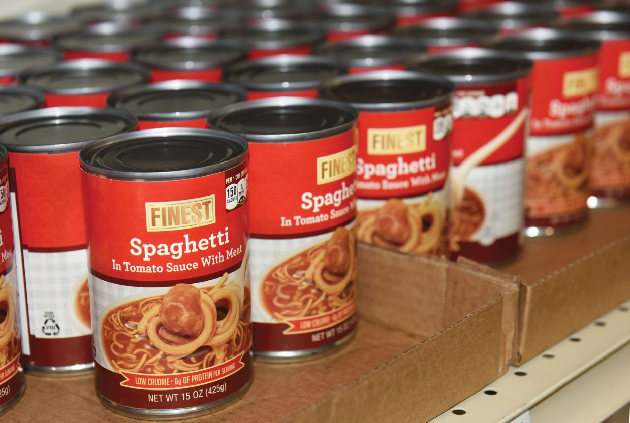Cans of spaghetti line the shelves at the new LiftUp of Routt County Food Bank. The food bank opened last month, as part of a three-phase expansion project that came to an end Tuesday with the re-opening of LiftUp's recently expanded thrift store.