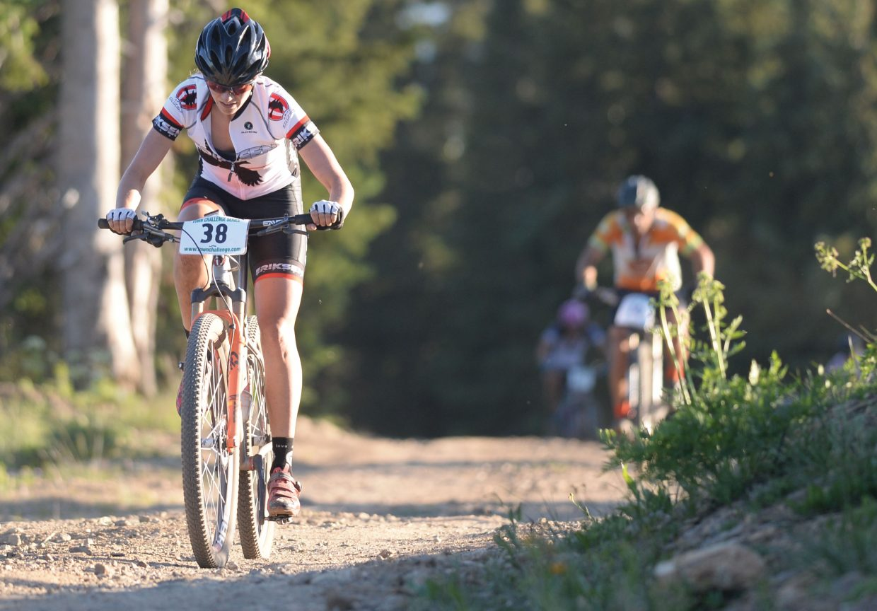 Hannah Williams races toward the finish line of the Storm Peak Hill Climb. Williams pulled away from Mindy Mulliken on the final steep uphill section of the 8.7-mile climb to win the women's Pro/Open division Wednesday evening.