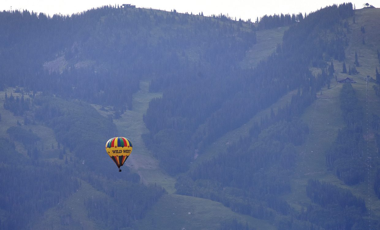 A balloon floats through the hazy early morning air in Steamboat Springs.