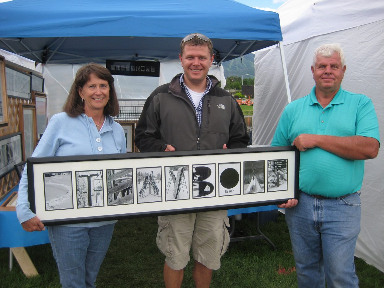Author Joel Reichenberger with his parents, Larry and Susie Reichenberger, during his first Art in the Park show.