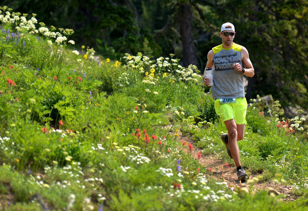 Dan Berteletti runs down the Mountain View trail above Steamboat Ski Area on Saturday during the Mount Werner Classic 50-kilometer trail ultra-marathon in Steamboat Springs. Berteletti won the race, finishing its 31 miles in 4 hours, 43 minutes and 20 seconds.
