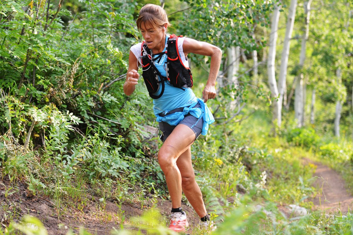 Anita Ortiz runs up a hill Saturday during the Mount Werner Classic at Steamboat Ski Area. She won the women's race.