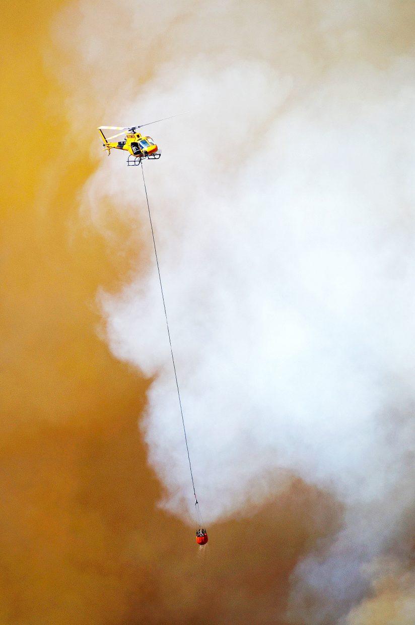 Federal resources, like this helicopter, have been called in to fight the Milk Fire near Colowyo Mine in Moffat County.