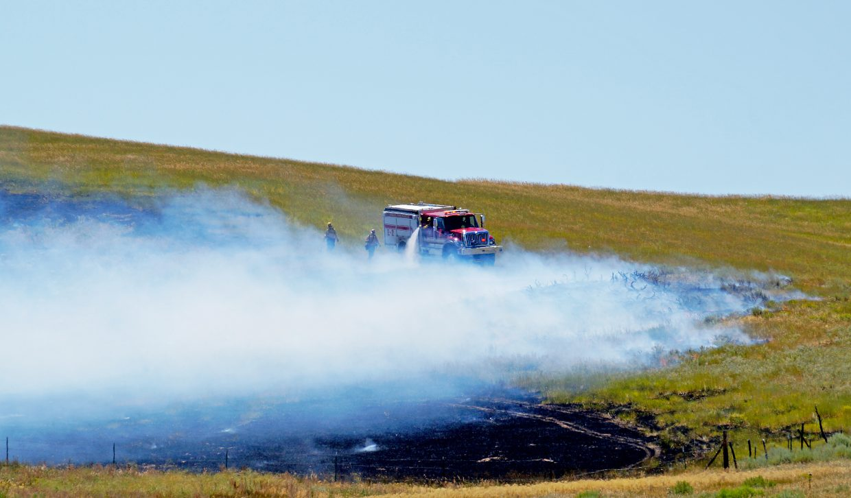 An engine from Craig Fire/Rescue makes works makes its way around the perimeter of a fire near Elkhead Reservoir.