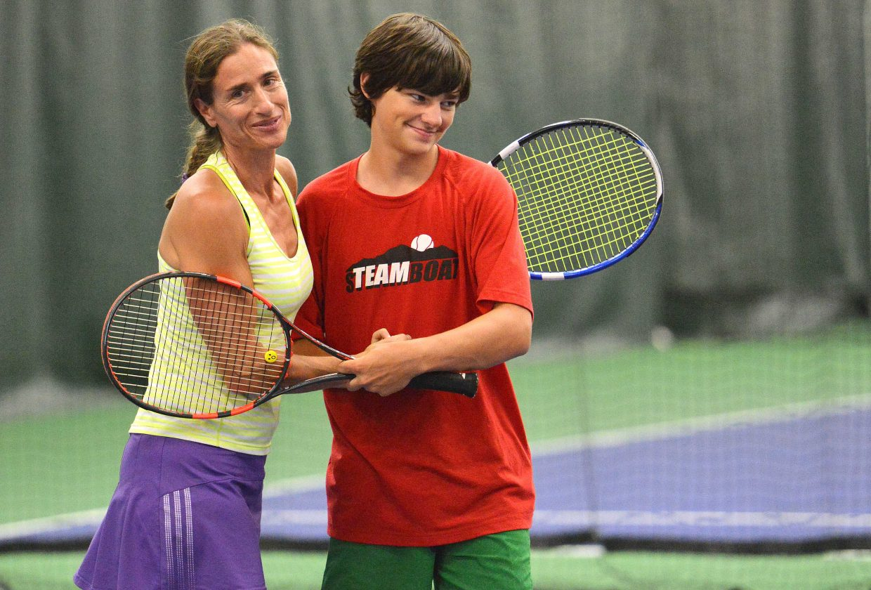 Karen Connell and Nolan Connell congratulate each other after closing out their final doubles match of the Steamboat Tennis Association Summer Championships tournament Sunday. The event, a fundraiser for STA, left many parents paired up playing with their children, a sometimes complicated, sometimes rewarding experience.