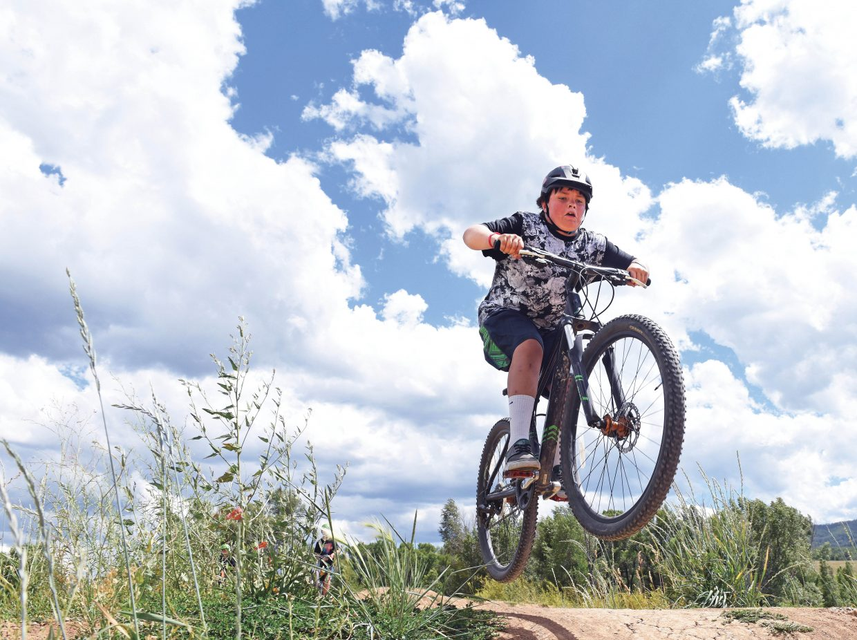 Aidan Story rides his bike over one of the jumps at the Bear River Park on Monday afternoon.