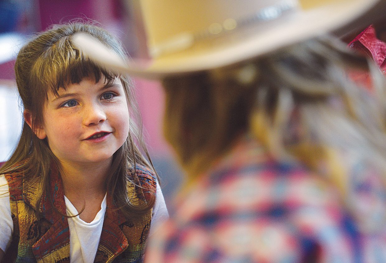 Cloverbud Charley Trout visits with a judge at the Routt County 4-H Exhibit Day Wednesday at Soroco High School in Oak Creek. Exhibit Day is when young 4-H members bring their projects to be scored by judges. On Friday, those results will be announced during an awards night that includes a fashion show. The Cloverbuds are still too young to take part in regular 4-H judging, but the Routt County Fair Royalty steps in to give the future 4-Hers a taste of what being a part of 4-H is all about.
