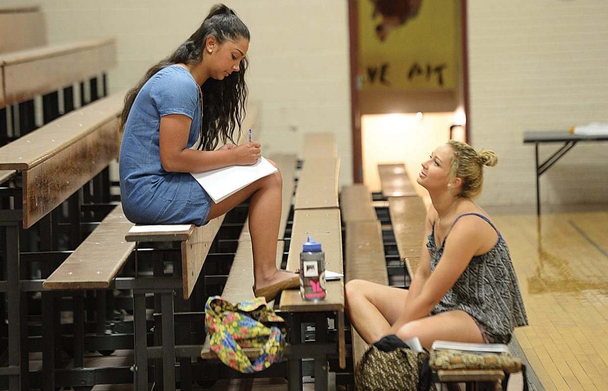 Laura Johnson writes her commentary for the 4-H Fashion Show while visiting with Emma Johnson. Local 4-Hers headed to Soroco High School Wednesday for the annual Exhibit Day judging. The 4-H members had their projects scored by judges and prepared for the annual fashion show, which will take place Friday as part of the 4-H awards ceremony. The top projects from that event will be sent on to the Colorado State Fair and Rodeo, which will take place next month in Pueblo.