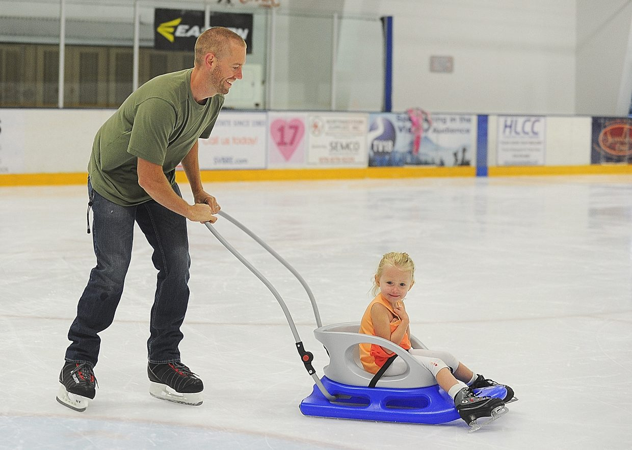 Will Hall gives Evolee Hall a push around the ice at the Howelsen Hill Ice Arena Monday afternoon. The Halls were visiting Steamboat Springs and decided to spend the afternoon at the ice arena.