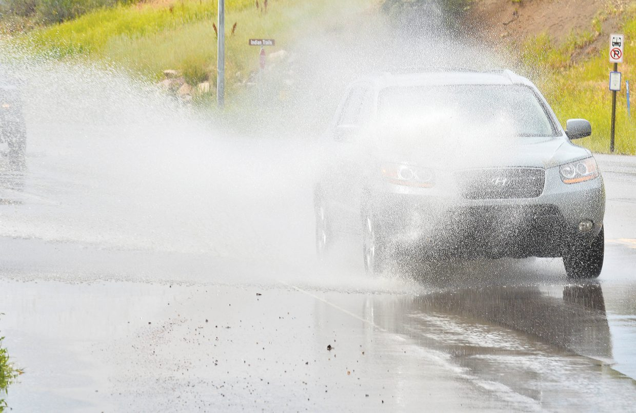 Cars drive through standing water along Lincoln Avenue just west of downtown during last week's downpour. Forecasts are calling for more monsoon rain this week.