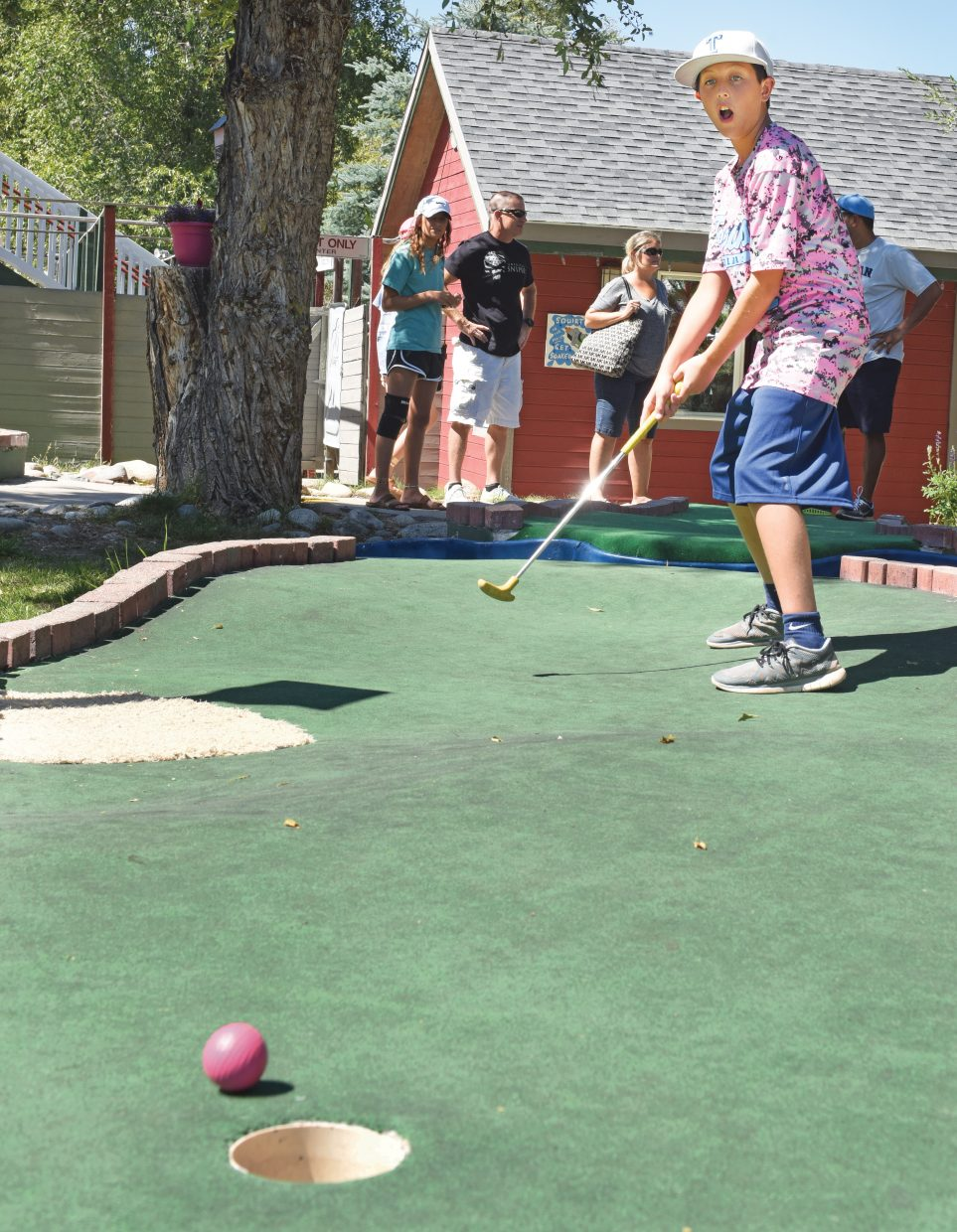 Collin Renteria plays miniature golf at Amaze'n Steamboat Family Fun Park in Steamboat Springs. Renteria was in town for the Triple Crown Baseball tournament, and was visiting the fun park with teammates and family.