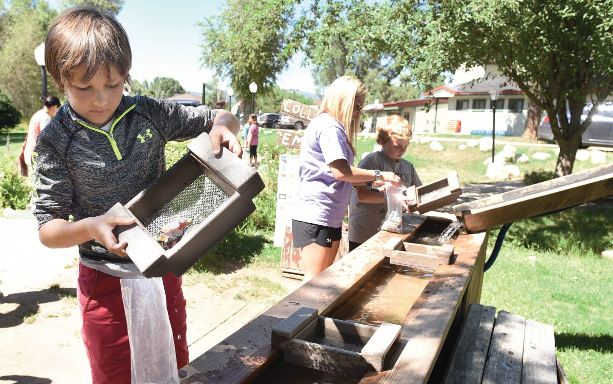Cannon Casey pans for treasure at the Amaze'n Steamboat Family Fun Park Tuesday afternoon. Cannon's mom Kathy Casey was helping family friend Brayden Jones in the background.