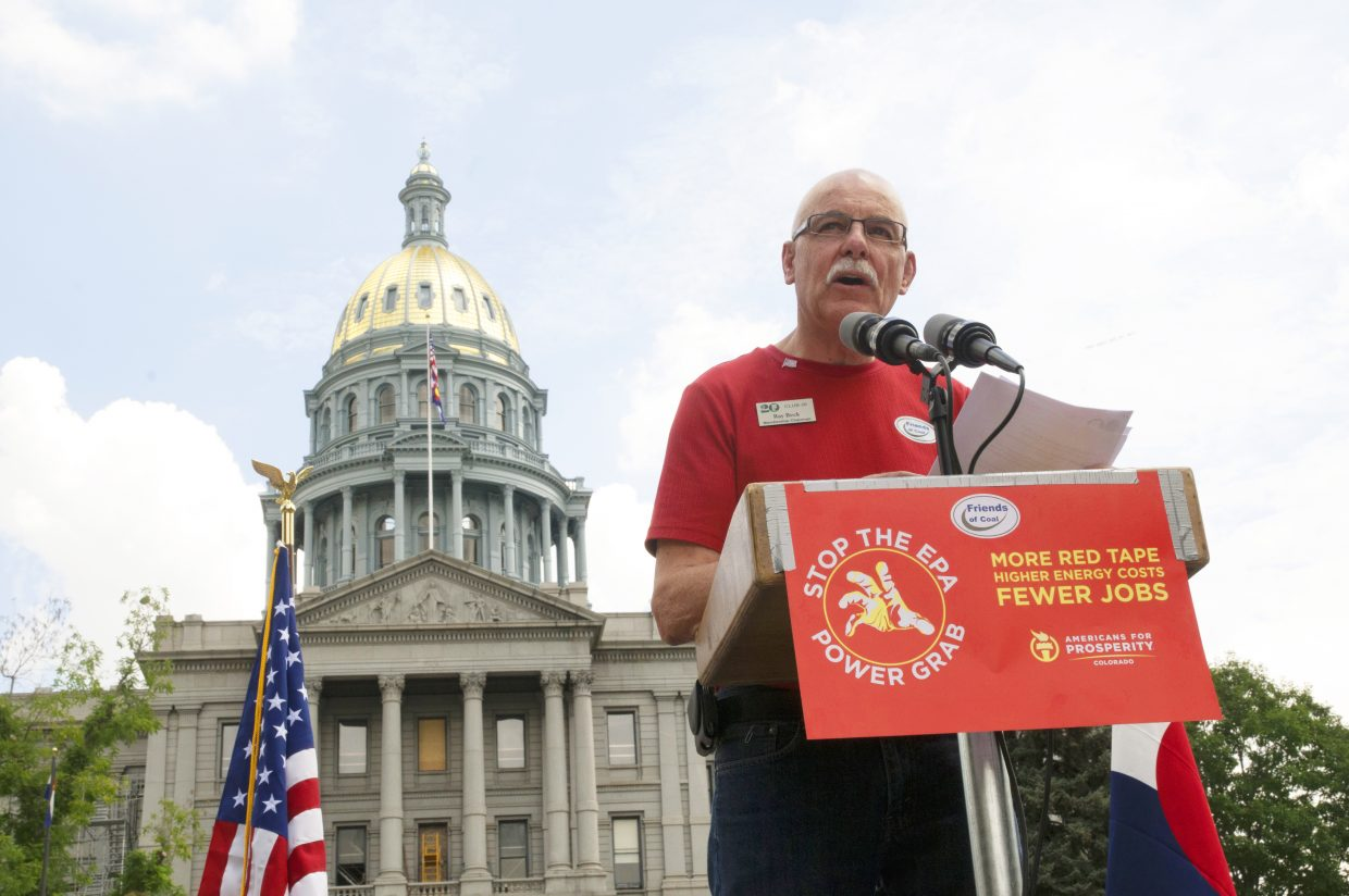 Craig resident Ray Beck addresses the crowd Tuesday afternoon near the state Capitol in Denver. Beck and many other Northwest Colorado residents turned out to support the coal industry during the Environmental Protection Agency's hearings.